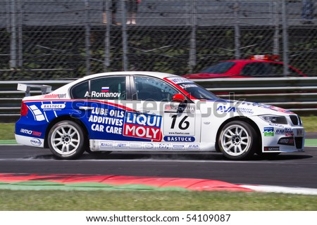 MONZA, ITALY - MAY 22: Andrei Romanov with his BMW 320si at FIA World Touring Car Championship 2010 on May 22, 2010 in Monza, Italy - stock photo