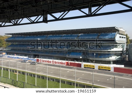 MONZA, ITALY - OCTOBER 27: Start grid and grandstand at Monza Formula One race track. Home of the Italian F1 Grand Prix October 27, 2008 in Monza, Italy - stock photo
