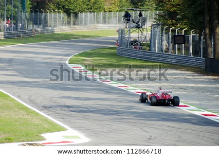 MONZA ( ITALY) - SEPTEMBER 7 : F. Alonso  Car's of Ferrari team  during Formula One practice day on September 7, 2012 in Monza, Italy - stock photo