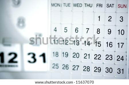 Mood shot of calendar with date and time background  - intentional selective focus, color-toning & vignetting - stock photo