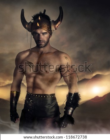 Moodey portrait of a muscular man as ancient warrior on battlefield - stock photo