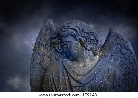 Moody Atmosphere with Statue of Guardian Angel on Dark Cloudy Background