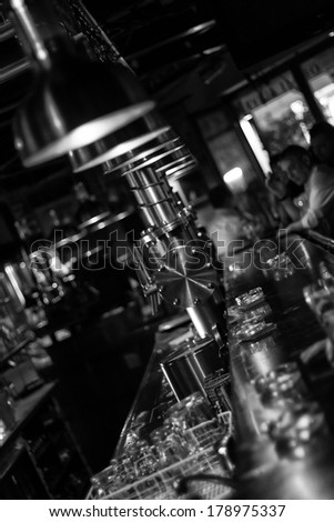 Moody bar in black and white