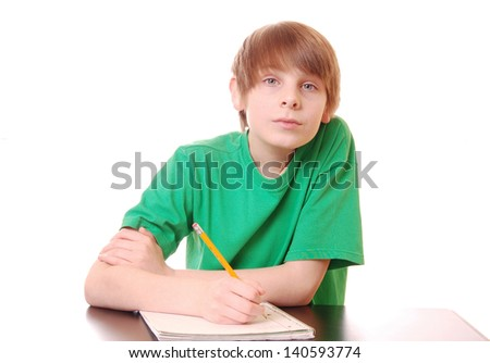 Moody Boy Doing His Homework (green shirt for easy color replacement) - stock photo