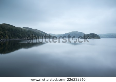 Moody landscape image of lake pre-dawn in Autumn - stock photo