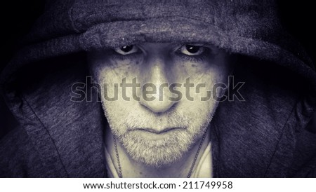 Moody man wearing a hooded sweater.
