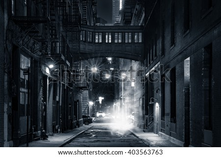 Moody monochrome view of Staple street skybridge by night, in Tribeca, New York City