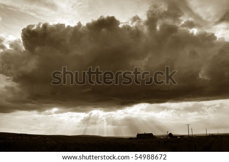 Moody Sky scape and house in Sepia