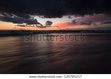 Moody sunset over the baltic sea photographed with long exposure