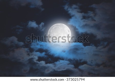 Moon among the clouds on a midnight sky. My astronomy work. No elements of NASA or other third party.
