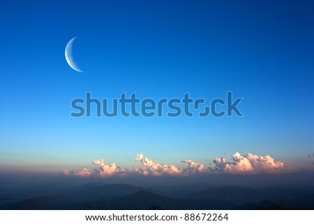 Moon and mountains. - stock photo