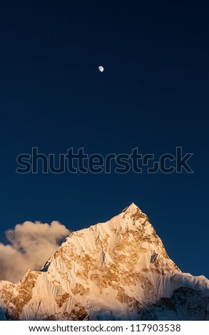 Moon and Nuptse (7864 m) at sunset (view from Kala Patthar) - Everest region, Nepal, Himalayas - stock photo