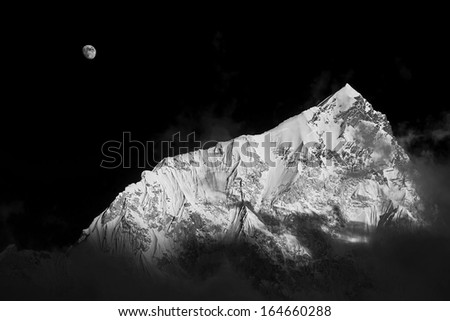 Moon and Nuptse (7864 m) at sunset (view from Kala Patthar) - Everest region, Nepal, Himalayas (black and white) - stock photo