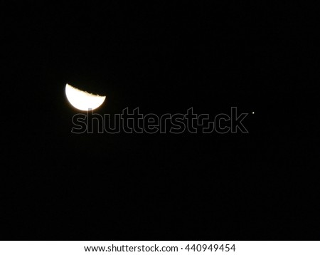 Moon and star in the sky at night