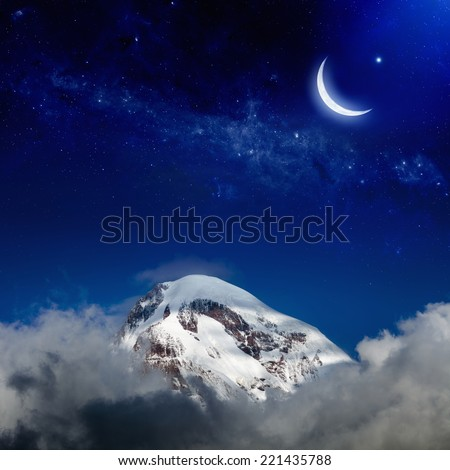 Moon and stars above snowy peak of mountain. Elements of this image furnished by NASA