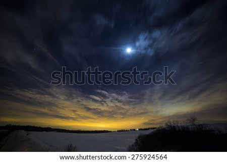 Moon and the stars in the night sky - stock photo