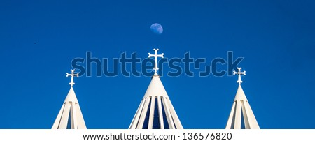 Moon and towers of Sarkis cathedral in Tehran, Iran - stock photo