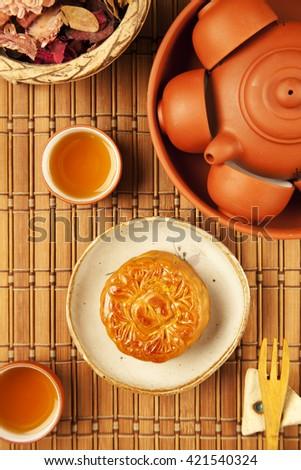 Moon cake and tea,Chinese mid autumn festival food.     - stock photo