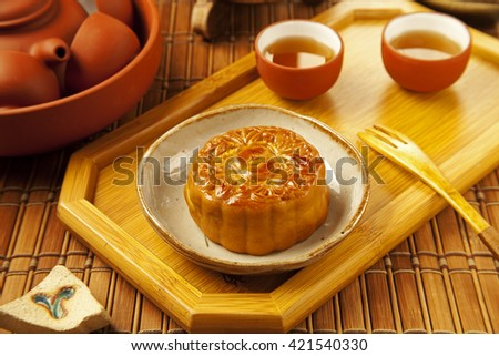 Moon cake and tea,Chinese mid autumn festival food.
