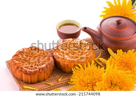 moon cake and tea for Chinese mid autumn festival. Isolated on white. Copy space - stock photo