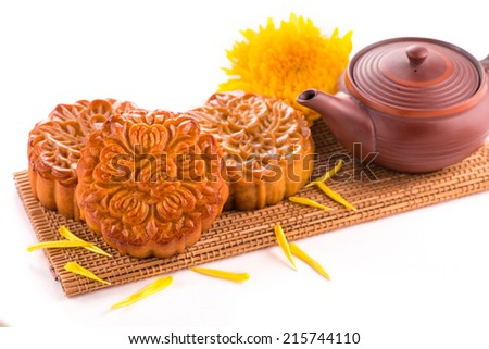 moon cake and tea for Chinese mid autumn festival. Isolated on white. Copy space