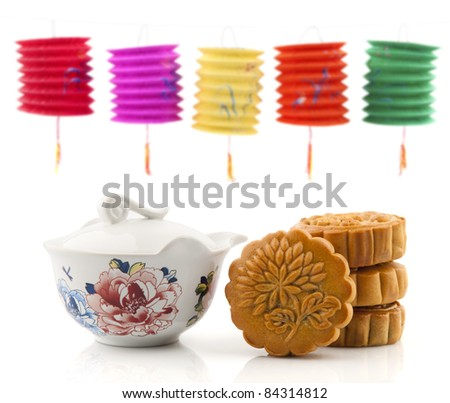 Moon Cake and Tea Set of Mid Autumn Festival, paper lantern as background - stock photo
