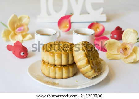 Moon cake, food for Chinese and Vietnamese mid-autumn festival. The shapes on moon cake are traditionally popular, and made by wooden mold - stock photo