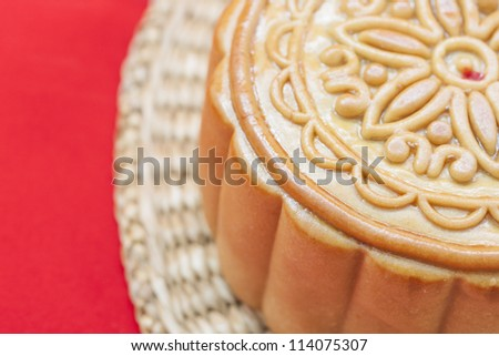 Moon cake on a bamboo mat..