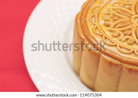 Moon cake on a white plate.. - stock photo