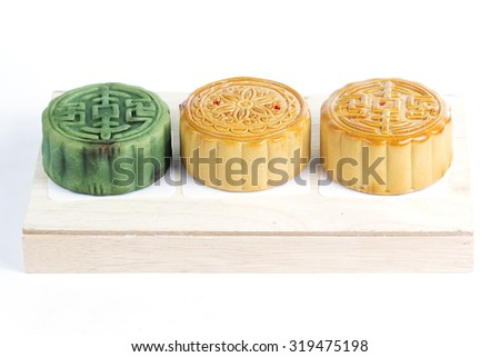 Moon cake on wooden tray / Autumn festival foods