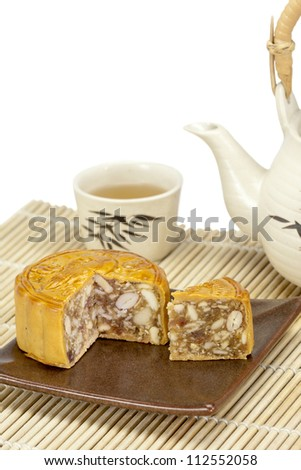 Moon cake with nuts and beans inside - stock photo