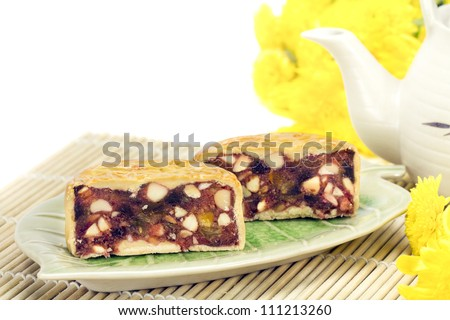 Moon cake with nuts and cream inside - stock photo