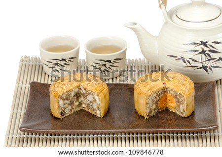Moon cake with nuts and yolk inside - stock photo