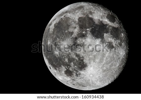 Moon closeup showing the details of the lunar surface. - stock photo