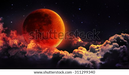 moon eclipse - planet red blood with clouds - moon map element  furnished by NASA  - stock photo