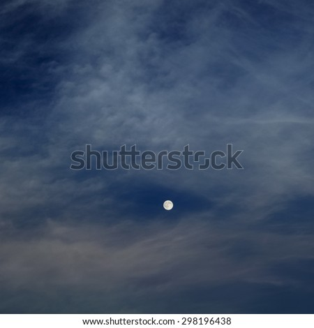 moon in dark night with clouds background - stock photo