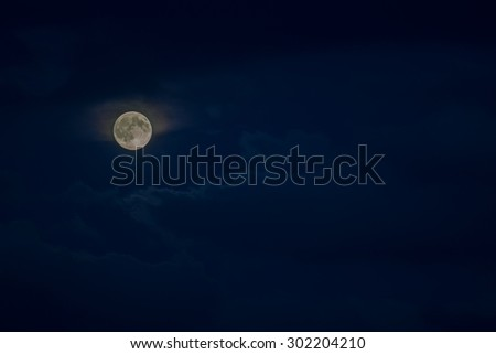 moon in the night sky cloudy - stock photo