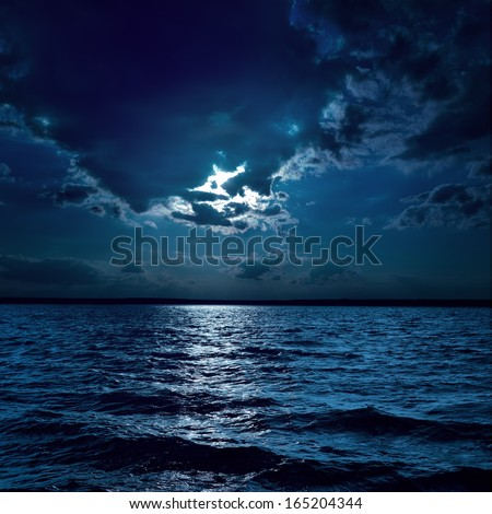 moon light over darken water in night - stock photo