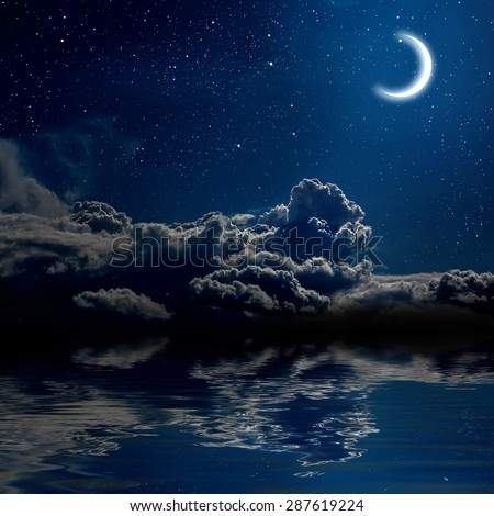 moon on a background star sky reflected in the sea. Elements of this image furnished by NASA - stock photo