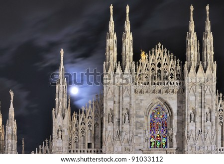 moon on cathedral steeples, Milan - stock photo