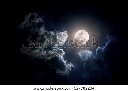 Moon on Cloudy day. - stock photo