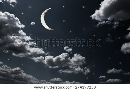 Moon on cloudy evening sky with shining stars - stock photo