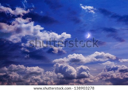 Moon on the sky with curly clouds - stock photo