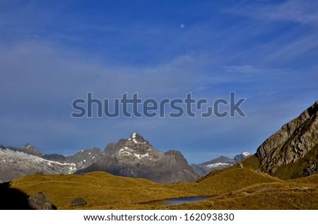 Moon Over Alpine Ridge, Routeburn Track  - stock photo