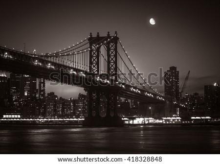 Moon over Manhattan. Silhouette of Manhattan Bridge and Manhattan Skyline at nigh. Old photo stylization, film grain added. Sepia toned - stock photo