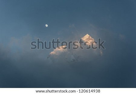 Moon over Mt. Everest and Nuptse at sunset (view from Kala Patthar) - Everest region, Nepal, Himalayas - stock photo