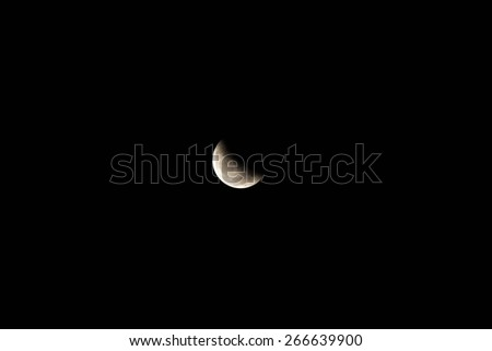 moon, partial lunar eclipse as seen from Thailand April 4th 2015 - stock photo