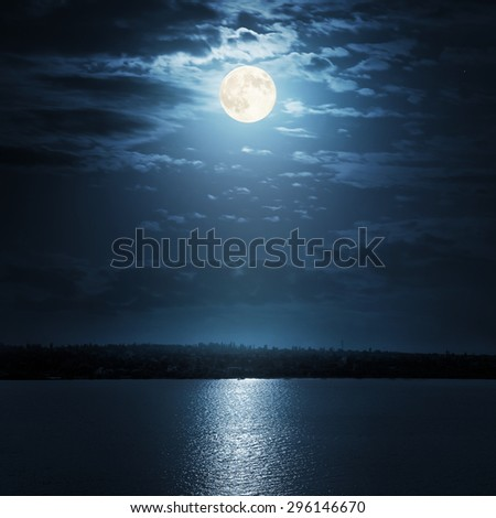 moon reflecting in a lake - stock photo