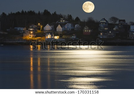 Moon Reflection on Kennebec River in Georgetown Island Maine. - stock photo