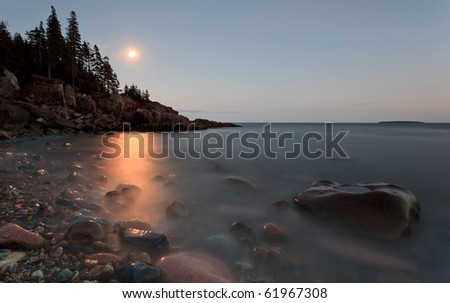 Moon Rise over acadia national park, otter point area. - stock photo